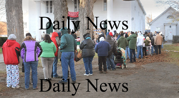 Amesbury:<br /> A line of people stretched to the sidewalk at the Main Steet Congregational Church in Amesbury as they arrived to accept turkey and other foods from Our Neighbor's Table food pantry. Police and fireman along with other volunteers handed out the Thanksgiving food.<br /> Photo by Bryan Eaton/Newburyport Daily News Wednesday, November 19, 2008