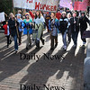 "Newburyport:<br /> Students from the River Valley Charter School head to Waterfront Park in Newburyport on their ""Hike for Hunger"" on Monday for a public rally at noon. They were raising money for Heifer International and accepting food donations for the Pettengill House food pantry in Salisbury.<br /> Photo by Bryan Eaton/Newburyport Daily News Monday, November 24, 2008"