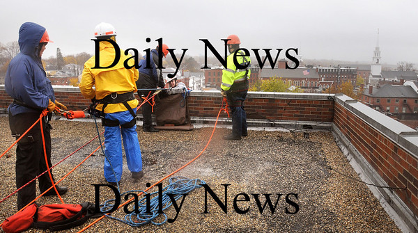 Newburyport:<br /> With the city of Newburyport as a backdrop, the Unitarian Church steeple to the right, local firefighters learn technical rescue techniques atop the Sullivan Building taught by the Massachusetts Firefighters Academy.<br /> Photo by Bryan Eaton/Newburyport Daily News Thursday, November 06, 2008