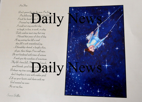 Newburyport:<br /> One page of Lisa Manley's calendar contains a poem by the late Susan Griffin.<br /> Photo by Bryan Eaton/Newburyport Daily News Thursday, November 20, 2008