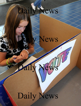 Salisbury:<br /> Hailey Johnson, 9, readies to vote in a mock election of the presidential race at Salisbury Elementary School yesterday morning. The different grades staggered voting throughout the day as some of the students played the part of election workers registering the others.<br /> Photo by Bryan Eaton/Newburyport Daily News Tuesday, November 04, 2008