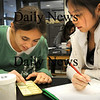 Salisbury:<br /> Harley Boschen, 12, and Jessica Nguyen, 11, put five mystery powders through different tests of physical and chemical changes trying to figure out what they are. They were learning scientific techniques through experimentation in Jane Purinton's class at Salisbury Elementary School.<br /> Photo by Bryan Eaton/Newburyport Daily News Wednesday, November 19, 2008