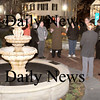 Amesbury:<br /> A small crowd gathered to dedicate the fountain in front of the Amesbury Public Library and relate remembrances of the former director Marc Lankin who died of cancer last year.<br /> Photo by Bryan Eaton/Newburyport Daily News Wednesday, November 12, 2008