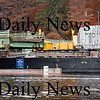 Amesbury:<br /> A loud bang was heard after this barge, carrying an electrical transformer, hit part of the Hines Bridge, moved back a couple feet, then continued on up the Merrimack River. The transformer was removed at the Amesbury town ramp near Larry's Marina for transportation to its final destination.<br /> Photo by Bryan Eaton/Newburyport Daily News Thursday, November 13, 2008