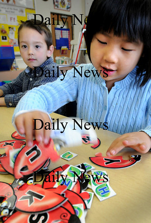 Newburyport:<br /> Aidan Emberton, left, and Anna Cameron, both 5, put together lady bug puzzles with letters in the alphabet in each one in kindergarten class at the Brown School in Newburyport. The children had raised lady bugs from larvae as they learned about the lives of insects.<br /> Photo by Bryan Eaton/Newburyport Daily News Thursday, November 06, 2008