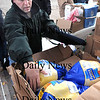 Amesbury:<br /> Our Neighbor's Table volunteer Scott Terry pulls turkeys from cartons as others handed canned goods, pototoes and bread to a line of people who showed up to receive the Thanksgiving food.<br /> Photo by Bryan Eaton/Newburyport Daily News Wednesday, November 19, 2008