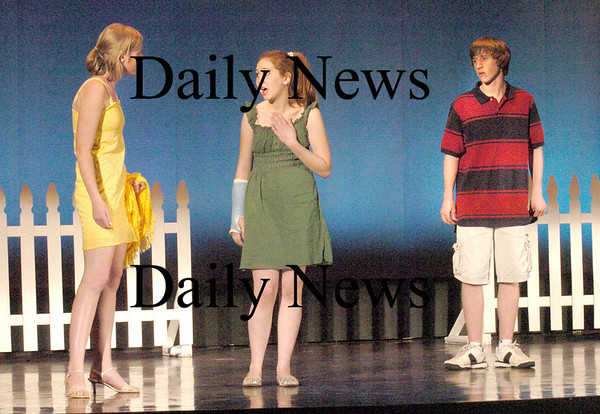 West Newbury:<br /> Pentucket High School is performing a Midnight Summers Dream. Rehearsing the opening scene, from left, Lisa Murray as Helena, Raina D'Orazio as Hermia and Dan Cashman as Lysander.<br /> Photo by Bryan Eaton/Newburyport Daily News Wednesday, November 12, 2008