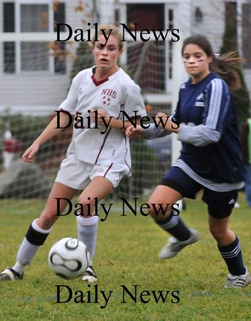 Newburyport:<br /> Newburyport's Taylor Bresnahan moves the ball past a Nazareth player yesterday at Cherry Hill Field.<br /> Photo by Bryan Eaton/Newburyport Daily News Friday, November 07, 2008