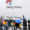 Newburyport:<br /> Nearly 30 people braved the rain yesterday at Cashman Park to dedicate a flagpole that was donated to the City by Newburyport residents Emmett Horgan and his family. It was being dedicated in honor of Wally Lyzinski, who was in attendance, and has been a driving force in restoring the waterfront and in creating the local Coast Guard Auxiliary. A plaque is now in place at the flapole noting WallyÕs efforts and the generosity of the Horgan family<br /> Photo by Bryan Eaton/Newburyport Daily News Tuesday, November 25, 2008