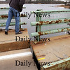 Newburyport:<br /> Newburyport Police Marshall Thomas Howard gets a first-hand look at the stuck section of the Hines Bridge yesterday.<br /> Photo by Bryan Eaton/Newburyport Daily News Thursday, November 13, 2008