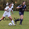 Newburyport:<br /> Laura Muise looks for a open teammate as she kicks the ball in action against Nazareth yesterday afternoon.<br /> Photo by Bryan Eaton/Newburyport Daily News Friday, November 07, 2008