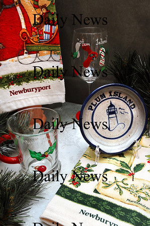 Newburyport:<br /> Hand-painted Newburyport and Plum Island holiday glasses and matching towels at Bountiful Baskets by the Sea.<br /> Photo by Bryan Eaton/Newburyport Daily News Monday, November 17, 2008