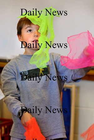 """Newburyport:<br /> Ben Peffer, 8, learns to """"toss and cross"""" scarves while learning the basics of juggling Wednesday morning. He was in Cathy Hill's physical education class at the Bresnahan School.<br /> Photo by Bryan Eaton/Newburyport Daily News Wednesday, November 19, 2008"""