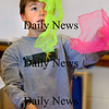 "Newburyport:<br /> Ben Peffer, 8, learns to ""toss and cross"" scarves while learning the basics of juggling Wednesday morning. He was in Cathy Hill's physical education class at the Bresnahan School.<br /> Photo by Bryan Eaton/Newburyport Daily News Wednesday, November 19, 2008"