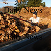 Amesbury:<br /> Tom Hodge of Monroe Street Mowing unloads leaves at Amesbury's compost facility on Elm Street.<br /> Photo by Bryan Eaton/Newburyport Daily News Monday, November 17, 2008