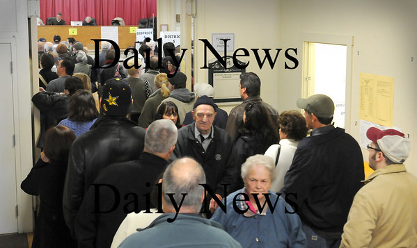 Amesbury:<br /> Voters in Amesbury Town Hall line up to cast their ballots in yesterday's election as others squeeze out after already voting.<br /> Photo by Bryan Eaton/Newburyport Daily News Tuesday, November 04, 2008