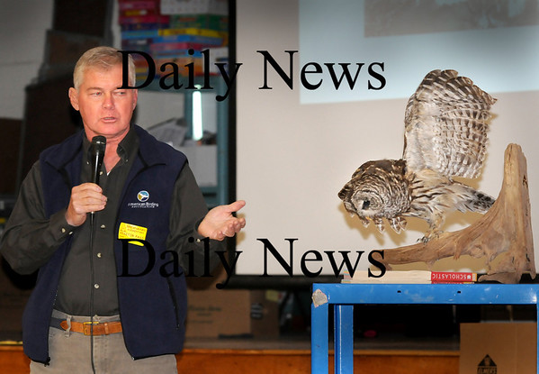Newburyport:<br /> Bird expert Steve Grinley spoke to Bresnahan School students in Newburyport about raptors including this stuffed barn owl Wednesday afternoon. The owl, which was found by a local family, appeared to have died from starvation was taken to a taxidermist and donated to the school.<br /> Photo by Bryan Eaton/Newburyport Daily News Wednesday, November 19, 2008