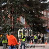 Newburyport:<br /> A small crowd gathered to watch as the Christmas tree was lowered into place in Newburyport's Market Square. The tree will be lit this coming Sunday following the arrival of Santa Claus on a U.S. Coast Guard vessel. <br /> Photo by Bryan Eaton/Newburyport Daily News Monday, November 24, 2008