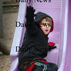 Amesbury:<br /> Colby Turner, 6, goes down the slide in the playground at Amesbury Elementary School on Monday afternoon. He was participation in the afterschool program there.<br /> Photo by Bryan Eaton/Newburyport Daily News Monday, November 24, 2008