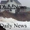 Newbury:<br /> Waves crash on Plum Island center during yesterday's storm, though the two giant sandbags below the deck in center of photo did offer some protection.<br /> Photo by Bryan Eaton/Newburyport Daily News Tuesday, November 25, 2008