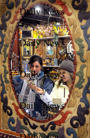 Newburyport:<br /> Tamra Galvin, 17, left, and Katie Brown, 19, both of Ipswich browse the offerings at Cool Jewels on State Street in Newburyport on Thursday afternoon. Photo by Bryan Eaton/Newburyport Daily News Thursday, November 20, 2008