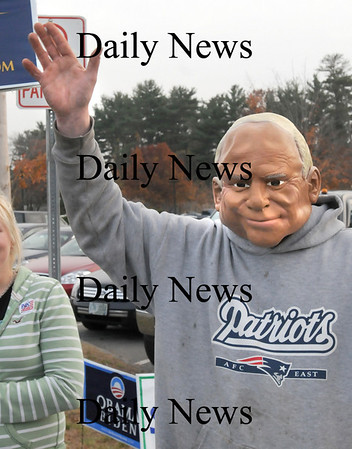 Seabrook:<br /> Paul Knight wears a mask of John McCain as he campaigns along Route One in Seabrook at the Recreation Center for his candidate.<br /> Photo by Bryan Eaton/Newburyport Daily News Tuesday, November 04, 2008