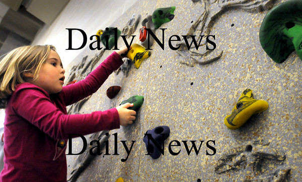 Amesbury:<br /> First-grader Devon Sanford, 6, looks for her next move on the climbing wall Friday at Amesbury Elementary School. Phys ed teacher Margaret Welch says the wall is one of the more popular activities for the children which helps with concentration and builds muscle strength.<br /> Photo by Bryan Eaton/Newburyport Daily News Friday, November 07, 2008