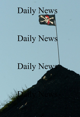 Newburyport:<br /> The Jolly Roger is planted atop a pile at the Crow Lane Landfill in Newburyport.<br /> Photo by Bryan Eaton/Newburyport Daily News Wednesday, November 19, 2008