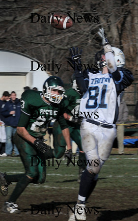 West Newbury:<br /> Triton's Matt Brimicombe catches a pass at Pentucket's John Troy moves in.<br /> Photo by Bryan Eaton/Newburyport Daily News Thursday, November 27, 2008