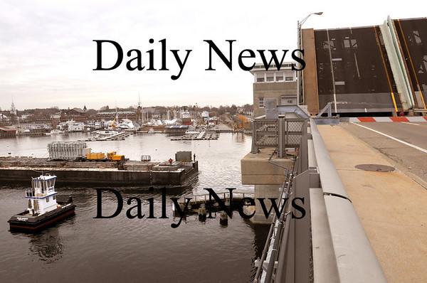 Newburyport:<br /> The barge moving a large transformer heads under the Gillis Bridge on Route One spanning the Merrimack River on its way to unload in Amesbury.<br /> Photo by Bryan Eaton/Newburyport Daily News Thursday, November 13, 2008
