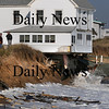 Newbury:<br /> Officials keep watch on this house at Plum Island in danger of falling in from being additionally undermined by Tuesday's storm and associated wave action.<br /> Photo by Bryan Eaton/Newburyport Daily News Wednesday, November 26, 2008