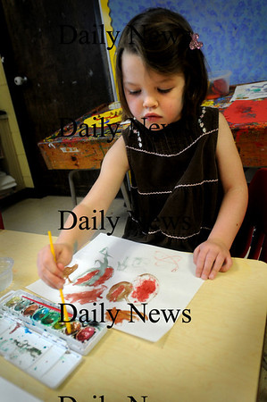 Amesbury:<br /> Elizabeth Cronin, 4, a preschooler at Amesbury Elementary School mixed different watercolors on Tuesday afternoon. Once complete, the paper was going to be cut into feathers for a turkey cut-out she was making.<br /> Photo by Bryan Eaton/Newburyport Daily News Tuesday, November 25, 2008