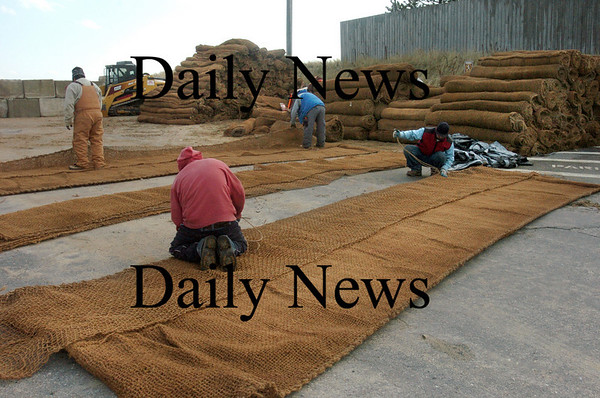 Newbury:<br /> A crew readies giant sand bags in the parking lot at Plum Island center.<br /> Photo by Bryan Eaton/Newburyport Daily News Wednesday, November 26, 2008