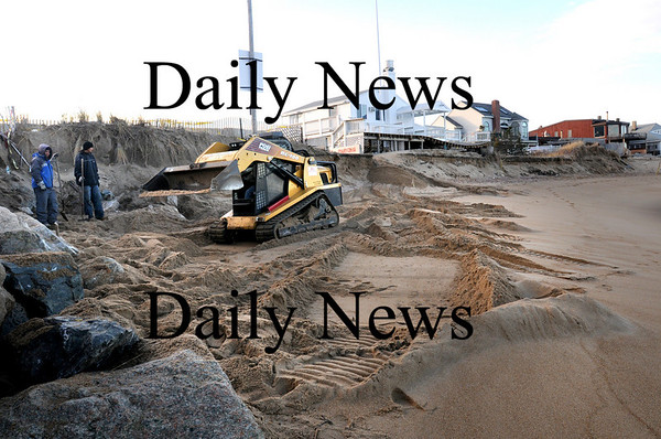Newbury:<br /> A crew prepares the beach at Plum Island Center for giant sandbags that will be placed there to aid against erosion.<br /> Photo by Bryan Eaton/Newburyport Daily News Monday, November 17, 2008