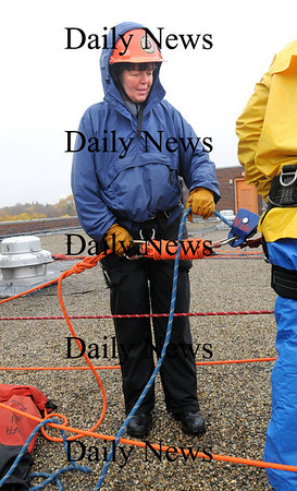 Newburyport:<br /> Newburyport firefigher Wendy Kimball-Murray mans one of the belaying lines from the top of the Sullivan Building in Newburyport during a rescue exercise being taught by the Massachusetts Firefighters Academy.<br /> Photo by Bryan Eaton/Newburyport Daily News Thursday, November 06, 2008