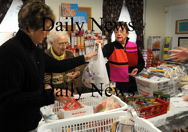 Salisbury:<br /> Pettengill House food pantry volunteers check boxes of food to make sure each have the full compliment for Thanksgiving dinners for those in need. From left, Lea Healey, Lucy Hailson and Diane LeSage.<br /> Photo by Bryan Eaton/Newburyport Daily News Tuesday, November 25, 2008