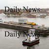 Newburyport:<br /> A tug boat pushes a barge loaded with an electrical transformer past the Newburyport waterfront on the Merrimack River to be offloaded in Amesbury.<br /> Photo by Bryan Eaton/Newburyport Daily News Thursday, November 13, 2008