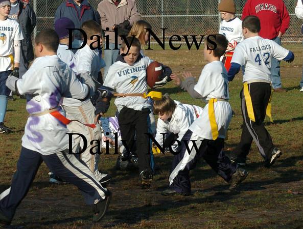 Salisbury:<br /> Joey Michael of the Vikings breaks through the Ravens defense during the Turkey Day Williams' Bowl at Salisbury Elementary School on Wednesday.<br /> Photo by Bryan Eaton/Newburyport Daily News Wednesday, November 26, 2008
