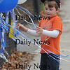 Georgetown:Fuller Albright, 4, of Seabrook checks out the balloons at the Georgetown/North Reading Football Game Saturday in Georgetown. Fuller was there to watch the game with his dad Bob.<br /> photo by Jim Vaiknoras/Newburyport Daily News Saturday November 8, 2008