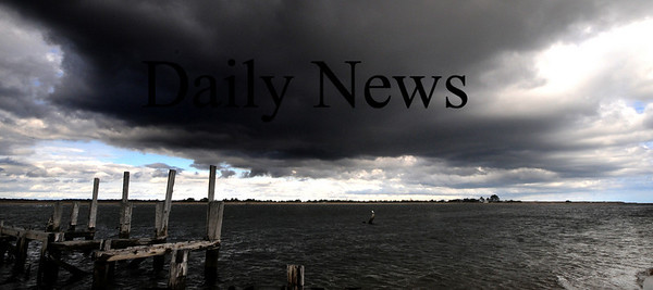 Newbury:Storm clouds clear over the Merrimack River Sunday morning as seen from Plum Island point.<br /> Photo by Jim Vaiknoras/Newburyport Daily News Sunday, November 16, 2008