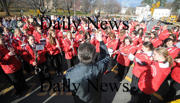 Amesbury:Thomas Horan conducts the Amesbury High School band as they play the National Anthem at the Amesbury Veteran Day ceremony at the Middle School Tuesday.photo by Jim Vaiknoras/Newburyport  Daily News. Sunday November 8, 2008