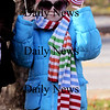 Amesbury: Kaitlyn Levenson, 6, is all bundled up and patriotic at the Amesbury Veteran Day ceremony at the Middle School Tuesday.photo by Jim Vaiknoras/Newburyport  Daily News. Sunday November 8, 2008