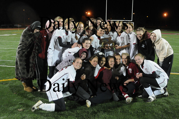 Lowell: The newburyport high girls soccer team pose for pictures after winning their 3rd straight North Sectional Title at Crowley Stadium in Lowell. The Clippers beat Bedford 2-1 in OT. photo by Jim Vaiknoras/Newburyport Daily News Sunday November 16, 2008