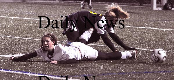 Lynn: Newburyport's Gabriela Martin gets knocked down aqainst Lynnfield at Manning Field in Lynn Thursday night.The Clippers won the game 1-0.photo by Jim Vaiknoras/Newburyport Daily News. Thursday November 13, 2008.