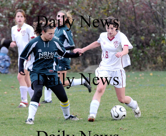 Newburyport: Newburyport's Sara Casey  fights for the ball against  North Reading Tuesday at Cherry Hill in Newburyport. The Clippers won the game 2-0.photo by Jim Vaiknoras<br /> /Newburyport  Daily News. Sunday November 8, 2008