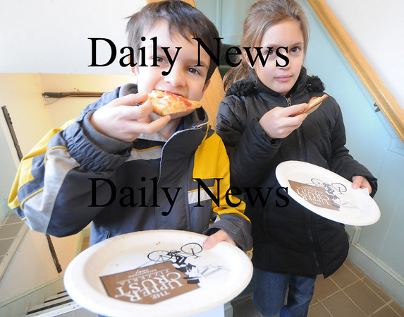 Newburyport: Nick Rogers, 7, and his sister Emily , 11, enjoy their pizza at the grand opening of Upper Crust in Newburyport Sunday afternoon. photo by Jim Vaiknoras/Newburyport Daily News. Sunday November, 23, 2008