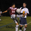 Wilmington:Yazid Eideh fight for the ball with a Wilmington player during their game at Wilmington sunday night. photo by Jim Vaiknoras/Newburyport Daily News. Sunday November 9, 2008