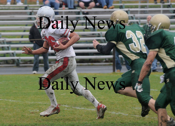 North Reading: Amesbury's Jesse Burell with a long gain during the Indians  game at North Reading Saturday. photo by Jim Vaiknoras/Newburyport Daily News, Saturday November 15, 2008