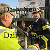 Newbury: Assistant Emergancy Manager Tim Leonard talks with Dept Fire Chief Dana Davis about damage to a home on Plum Island. Waves under cut sand at house on causing it to tilt towards the ocean. photo by Jim Vaiknoras/Newburyport Daily News, Wednesday November 26, 2008