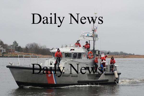 Newburyport:The Coast Guard brings in Santa and Mrs. Claus to the Newburyport waterfront in the rain Sunday night.photo by Jim Vaiknoras/Newburyport Daily News.Sunday November 30, 2008